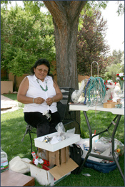 Navajo woman making and selling jewelry. Photo by Joyce Alexander; copyright Crow Canyon Archaeological Center.