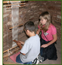 Students learning how to weave on a Pueblo loom at Crow Canyon.