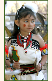 Pueblo girl dancing in traditional costume.
