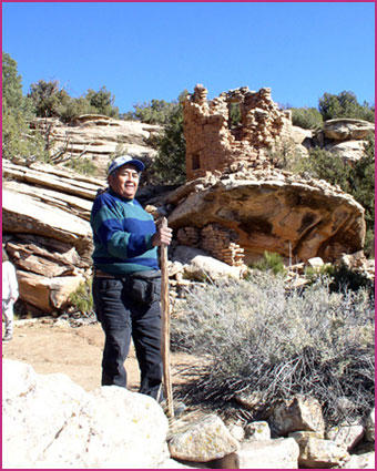 Pueblo man visiting an ancient Pueblo archaeological site in the Mesa Verde region.