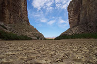 desert floor with two large cliffs on each side of an passage to open desert in Northern New Mexico