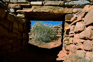Lowery Pueblo interior shot artistically framed by the stone entrance and lentel.