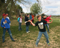 Pleasant View student usign an atlatl