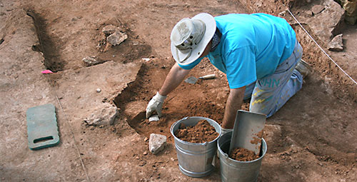 Participant in Crow Canyon's Archaeology Research Program excavating at the Dillard site.