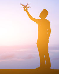 bigstock-silhouette-of-one-man-use-a-dr-2